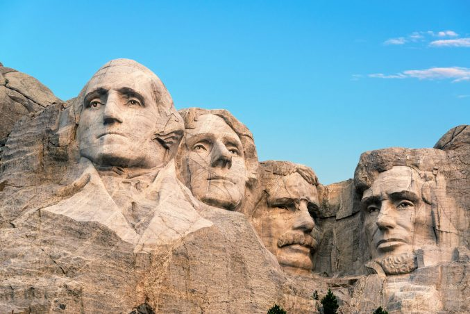 low-angle-view-of-statues-at-mount-rushmore-national-memorial-against-sky-903996590-5c48a933c9e77c00019afb1e