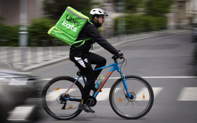 An Uber Eats courier is seen in Bucharest, Romania on May 1, 2019. (Photo by Jaap Arriens/NurPhoto via Getty Images)
